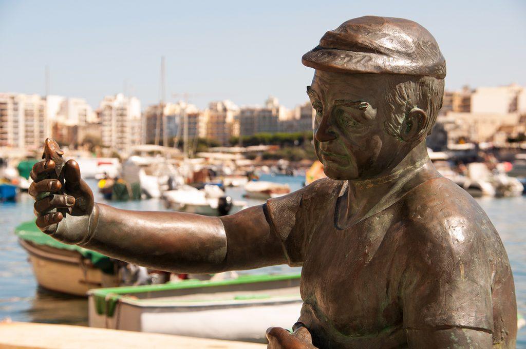 spinola bay malta island fisherman