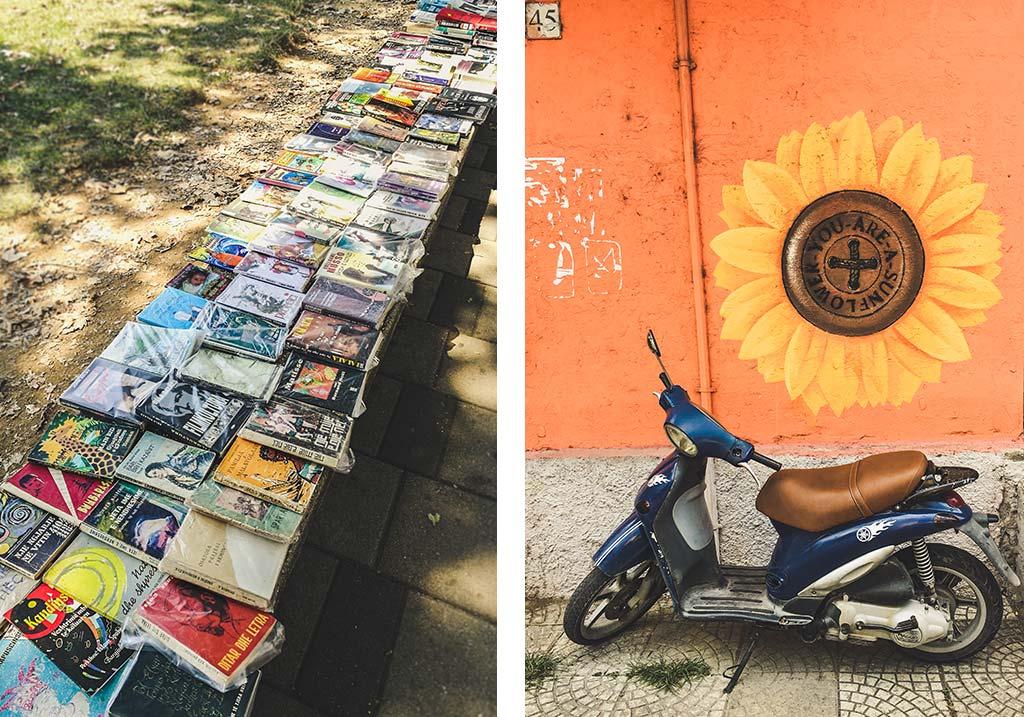 książki na murku i skuter na tle graffiti