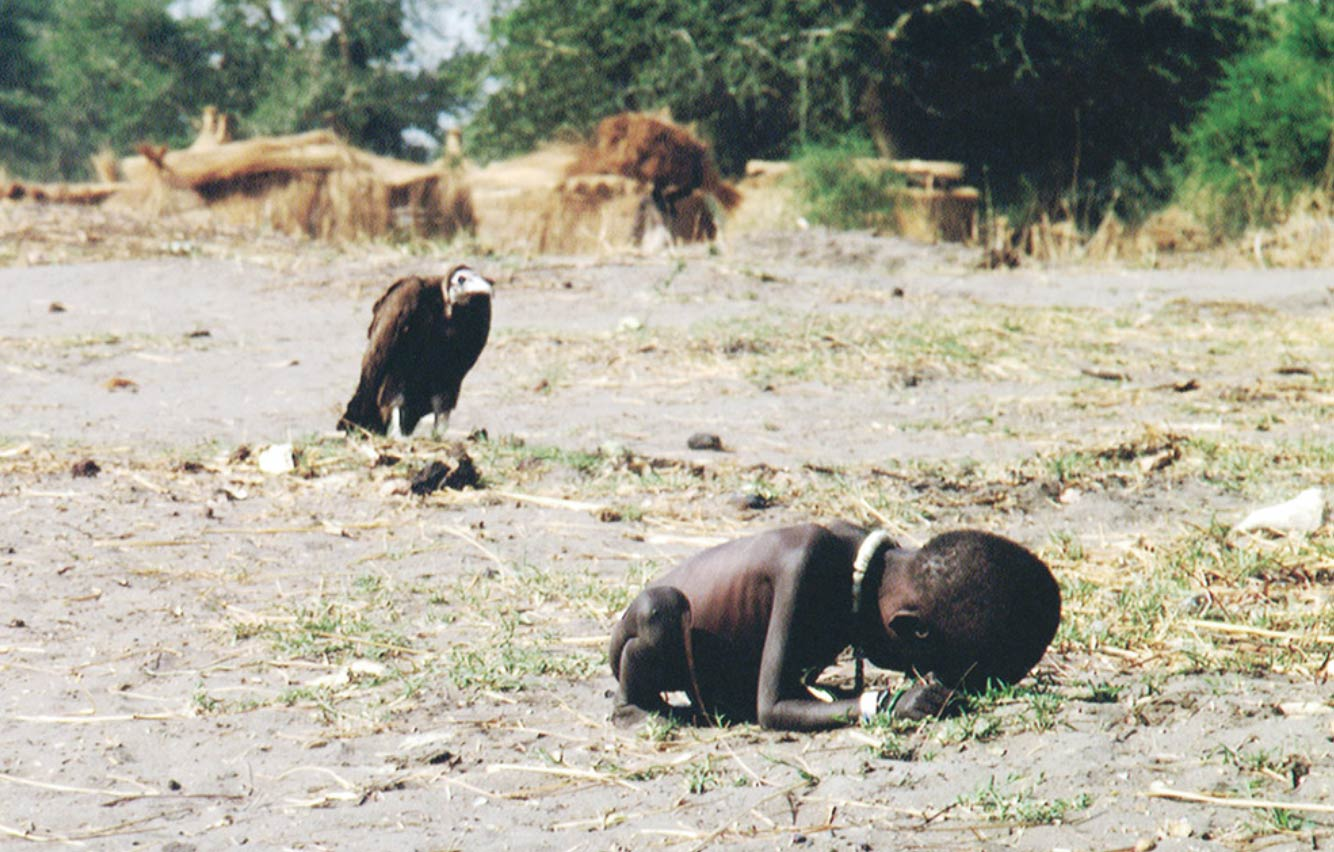 vulture and a girl in sudan